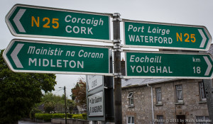 A road sign in Castlemartyr, Ireland. Cork, Midleton, and Waterford all have distilleries either operating or under construction. Photo ©2011 by Mark Gillespie.