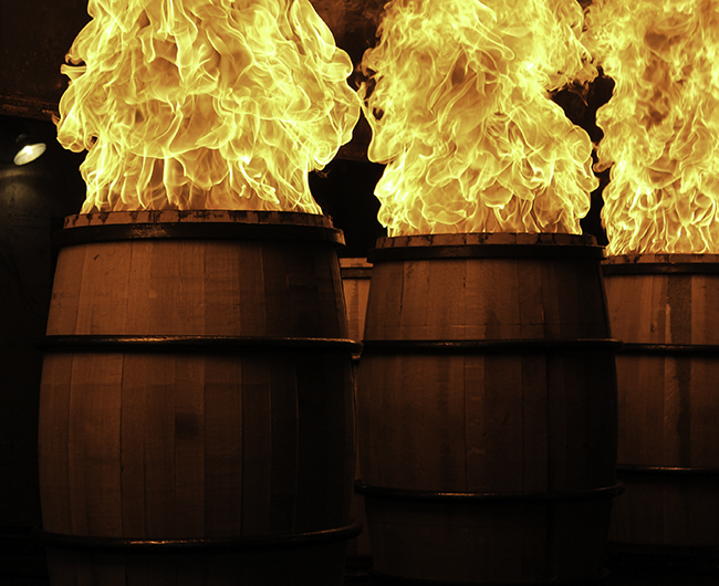 Whiskey barrels being charred at the Brown-Forman Cooperage in Louisville, Kentucky. Photo ©2017, Mark Gillespie/CaskStrength Media.