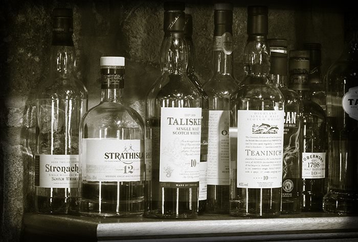 Bottles behind the bar at the Huntly Castle Hotel in Huntly, Scotland. Photo ©2016, Mark Gillespie, CaskStrength Media.