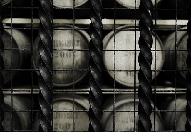 Barrels being held behind bars (for their own protection) at Glen Garioch Distillery in Scotland. Photo ©2016, Mark Gillespie/CaskStrength Media.