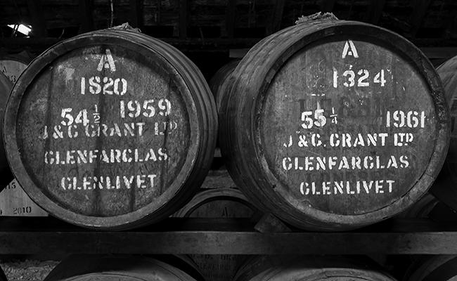 Casks of vintage Scotch Whisky maturing in a warehouse at Glenfarclas Distillery. Photo ©2015, Mark Gillespie/CaskStrength Media.
