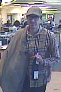 The suspect in the theft of a bottle of Glenfiddich 50 from the LCBO Queen's Quay store in Toronto. Photo courtesy LCBO via National Post.