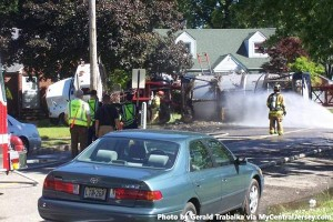 Firefighters and police respond to a tanker truck of Scotch whisky that crashed and caught fire in Woodbridge, New Jersey Wednesday, June 5, 2013. Photo by Gerald Trabalka via MyCentralJersey.com.