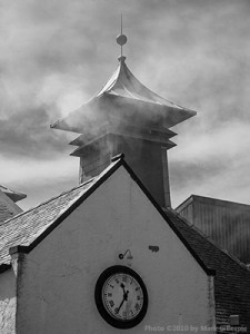 Peat smoke coming from the pagoda at Laphroaig Distillery on Islay. Photo © 2010 by Mark Gillespie.