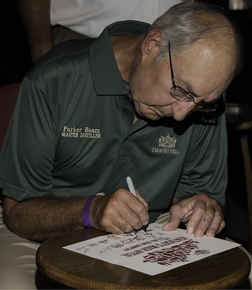 Parker Beam, Heaven Hill Master Distiller and the winner of Whisky Magazine's U.S. Distillery Manager of the Year Icons of Whisky Award for 2014, signs autographs during the Kentucky Distillers Association All-Star Sampler event at the Kentucky Bourbon Festival, September 18, 2013. Photo ©2013 by Mark Gillespie.
