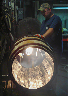 An Independent Stave Company cooper inspects a Bourbon barrel at the company's Lebanon, KY cooperage in this 2008 file photo. Photo ©2008 by Mark Gillespie.