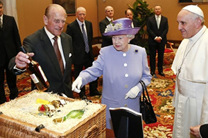 Prince Philip displays a bottle of Balmoral Scotch Whisky distilled at Royal Lochnagar Distillery as Queen Elizabeth presents a gift basket to Pope Francis at the Vatican on April 3, 2014. Reuters Photo by Stefano Rellandini.