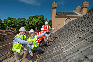 Wemyss Malts owner William Wemyss (at rear) toasts the completion of the roof at Kingsbarns Distillery with Doug Clement, distillery manager Peter Holroyd, and construction manager Ian Bownes. Photo by Douglas Robertson courtesy Wemyss Malts.