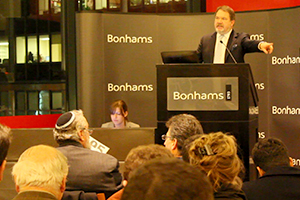 Bonhams Co-Chairman Malcolm Barber conducts a whisky auction December 8, 2011 at the Bonhams gallery in New York City. Photo ©2011 by Mark Gillespie.