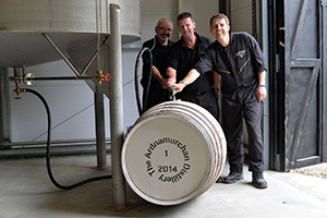 Ardnamurchan manager Graeme Bowie (center) fills the distillery's first cask with Gordon MacKenzie (L) and Mark Armin Giesler (R). Photo courtesy Adelphi Distillery Ltd.