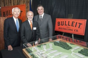 Kentucky Gov. Steve Beshear, Tom Bulleit, and Diageo North America President Larry Schwartz gather around a 3D model of the new Bulleit Distilling Co. distillery on which they helped break ground August 21, 2014. Image courtesy Diageo.
