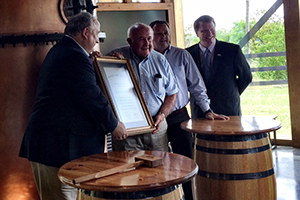 Jimmy Russell (C) accepts a lifetime honorary membership from Kentucky Distillers Association Chairman Joe Fraser (L), Wild Turkey's Rick Robinson (second from right) and KDA President Eric Gregory (far right). Photo courtesy KDA.