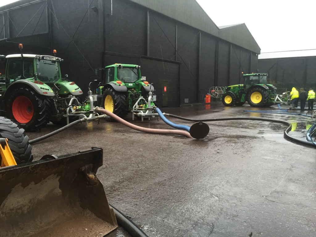 Workers pump flood water from the maturation warehouses at Ireland's Midleton Distillery. Photo courtesy Irish Distillers.