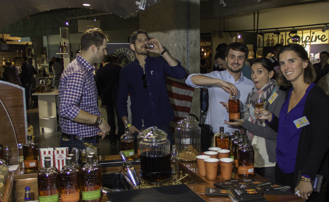 French whisky connoisseurs gather at a Bulleit Bourbon display during Whisky Live Paris in September, 2015. Photo ©2015 by Mark Gillespie.