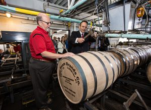 Kentucky Governor Matt Bevin hammers the bung into Jim Beam's 14 millionth barrel, May 2, 2016, at the Jim Beam American Stillhouse in Clermont, Kentucky with Fred Noe, Jim Beam's great-grandson and seventh generation master distiller. Photo courtesy Beam Suntory.