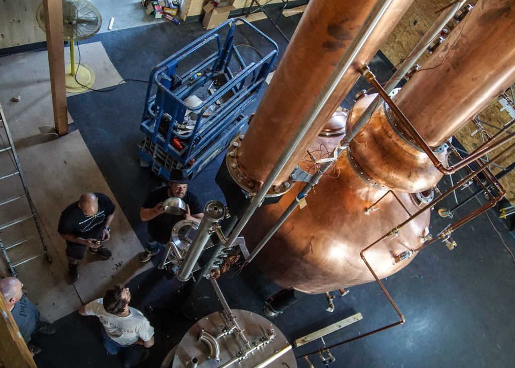 WhistlePig Master Distiller Dave Pickerell (with hat) during installation of the distillery's still in 2015. Image courtesy WhistlePig Rye.