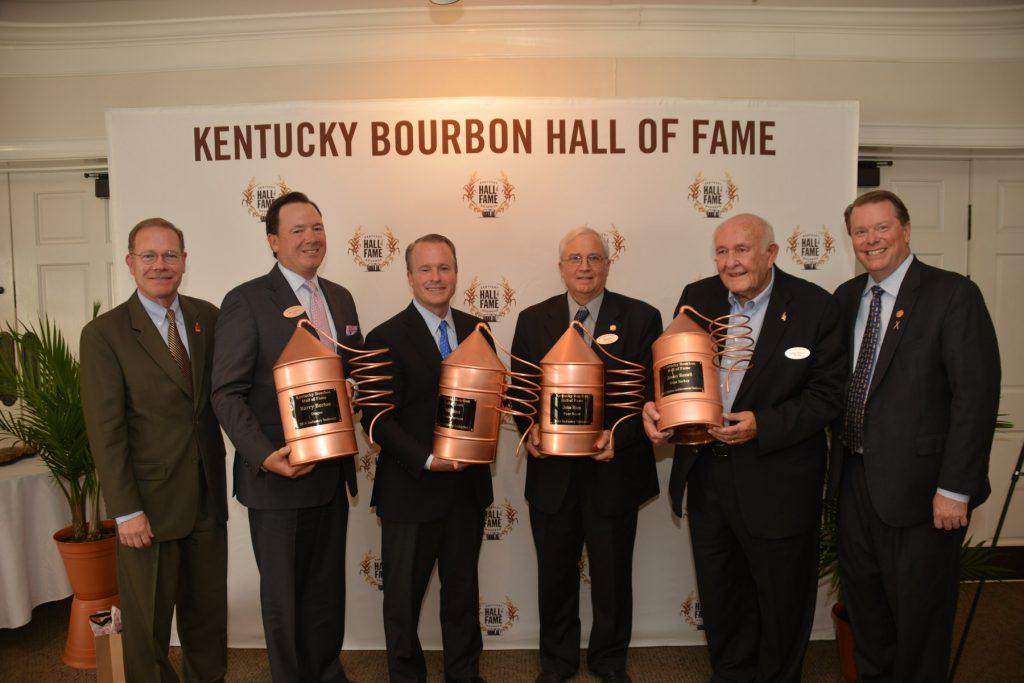 Chris Morris, Master Distiller at Brown-Forman and Chairman of the Kentucky Distillers' Association Board of Directors, and KDA President Eric Gregory welcome the 2016 class of the Kentucky Bourbon Hall of Fame. Pictured are Morris; Barry Becton, Diageo North America; Paul Varga, President & CEO of Brown-Forman, accepting on behalf of Bill Street; John Rhea, retired COO of Four Roses Distillery; Jimmy Russell, Master Distiller at Wild Turkey and recipient of the Parker Beam Lifetime Achievement Award; and Gregory. Not pictured is Joy Perrine. Photo courtesy Kentucky Distillers Association.
