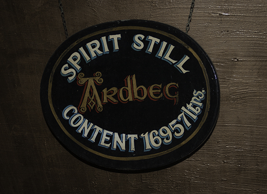 The vintage sign on Ardbeg Distillery's spirit still. Photo ©2016, Mark Gillespie, CaskStrength Media.
