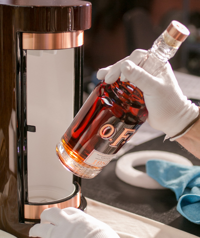A bottle of Buffalo Trace's O.F.C. Vintage 1982 Bourbon being placed in its presentation box. Image courtesy Buffalo Trace.