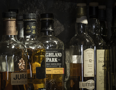 Whiskies on the shelf at a Scottish pub. Photo ©2016, Mark Gillespie/CaskStrength Media.