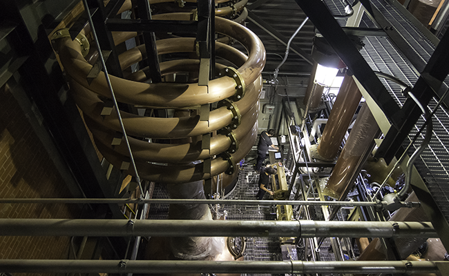 The unique coiled Lyne arms at the top of the spirit stills at Balcones Distilling in Waco, Texas. Photo ©2017, Mark Gillespie, CaskStrength Media.