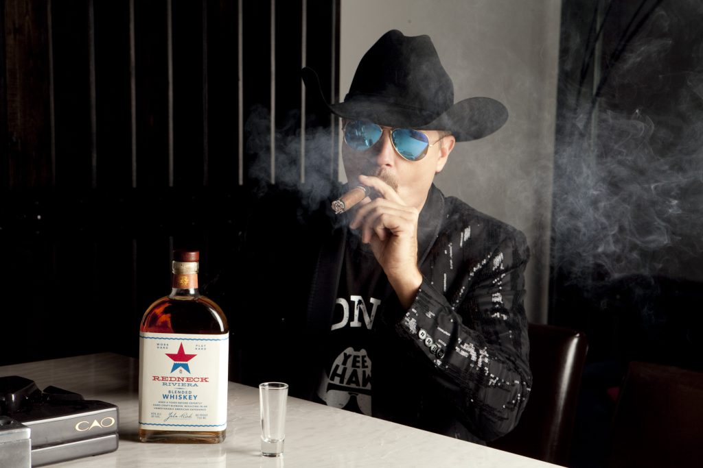 "Country music star John Rich with the ""Redneck Riviera"" whiskey created in partnership with Eastside Distilling. Photo courtesy Eastside Distilling."