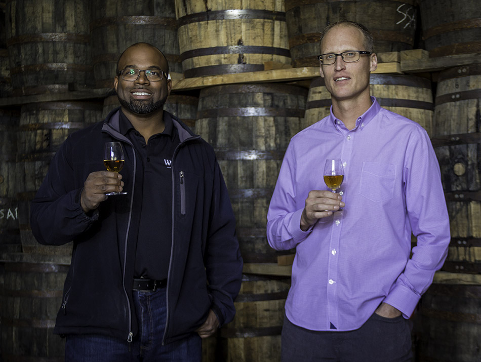 Hiram Walker Distillery warehouse supervisor Donald Campbell (L) and Master Blender Dr. Don Livermore (R) in one of the 16 maturation warehouses at the distillery's warehouse campus near Windsor, Ontario. Photo ©2017, Mark Gillespie, CaskStrength Media.
