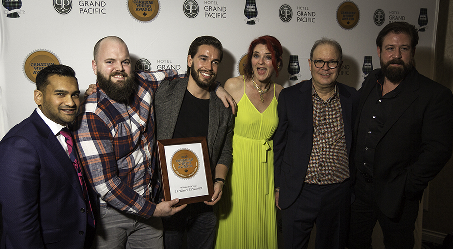 Corby Spirit & Wine executives celebrate with Heather Leary and Davin de Kergommeaux of the Canadian Whisky Awards. Photo ©2018, Mark Gillespie/CaskStrength Media.