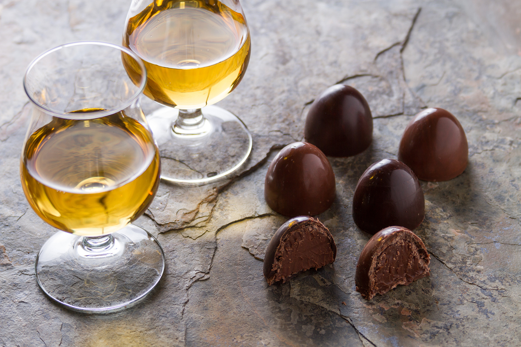 Whisky glasses and chocolates. Image courtesy Shutterstock.