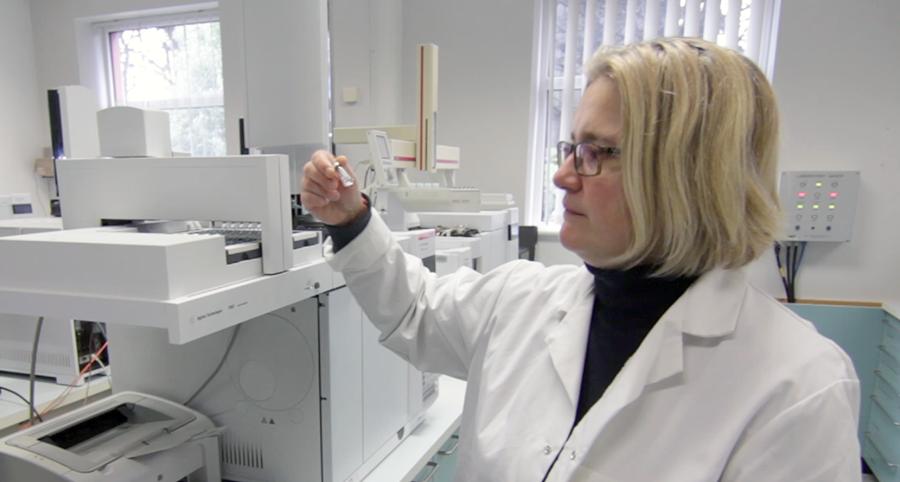 Irish Distillers chemist Dr. Dagmara Dabrowska examines whisky samples in the Midleton Distillery laboratory. Photo ©2018, Mark Gillespie/CaskStrength Media.