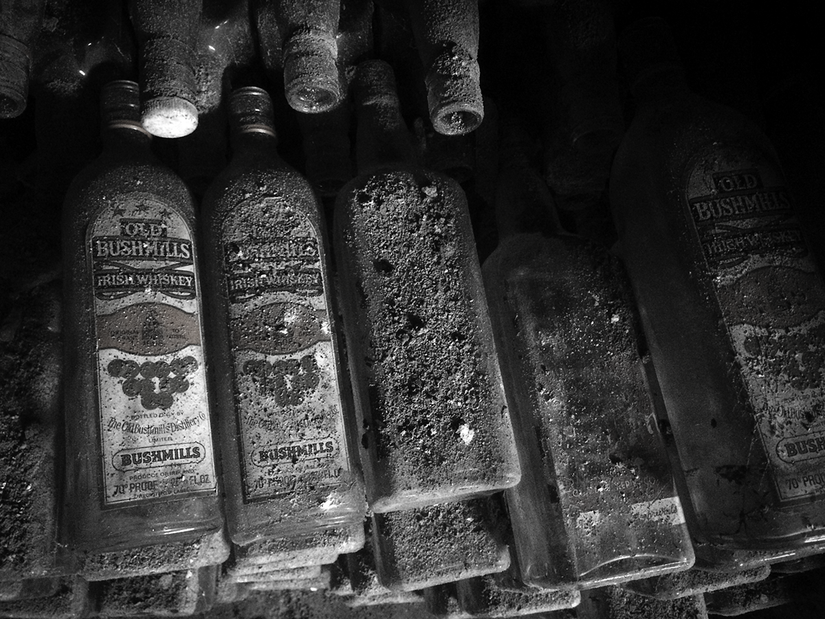 Vintage empty bottles of Bushmills found in the basement of a pub in Waterford, Ireland. File photo ©2019, Mark Gillespie/CaskStrength Media.