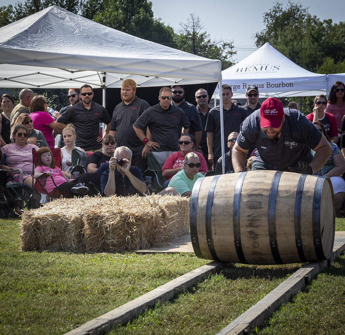 A member of the O.Z. Tyler barrel rolling team competes in the World Championship Bourbon Barrel Relay during the 2017 Kentucky Bourbon Festival. Photo ©2019, Mark Gillespie/CaskStrength Media.