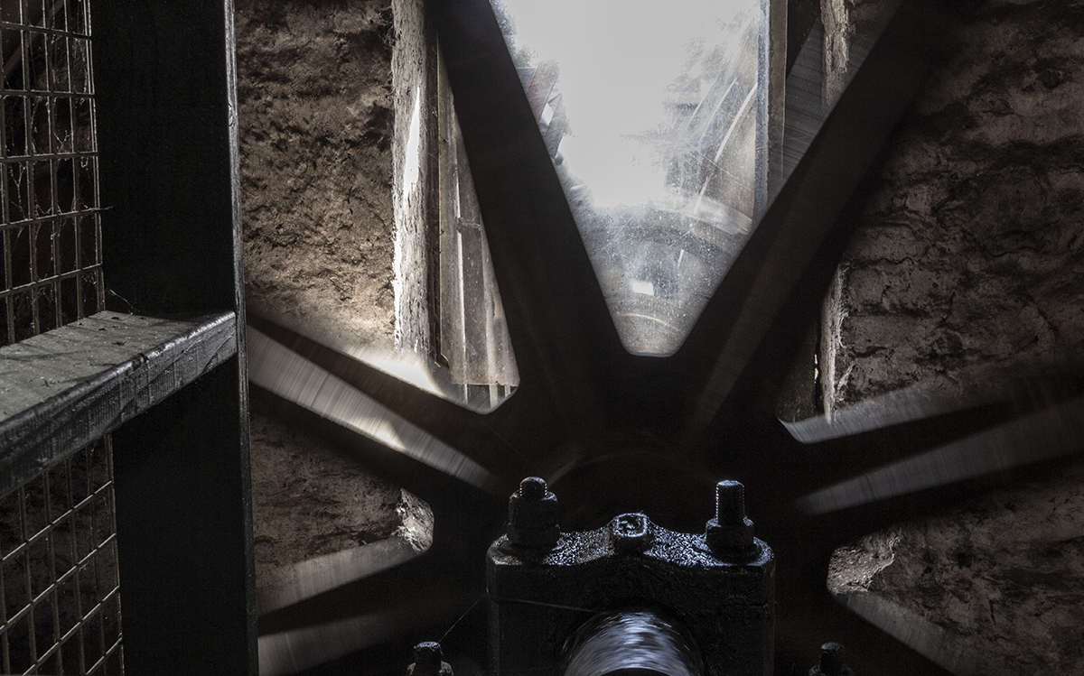 The days of water-driven mills are largely a thing of the past at many distilleries, but the old water wheel and mill at Ireland's Kilbeggan (formerly Locke's) Distillery was restored several years ago to working order. This view from inside the mill room is our Whisky Photo of the Week.