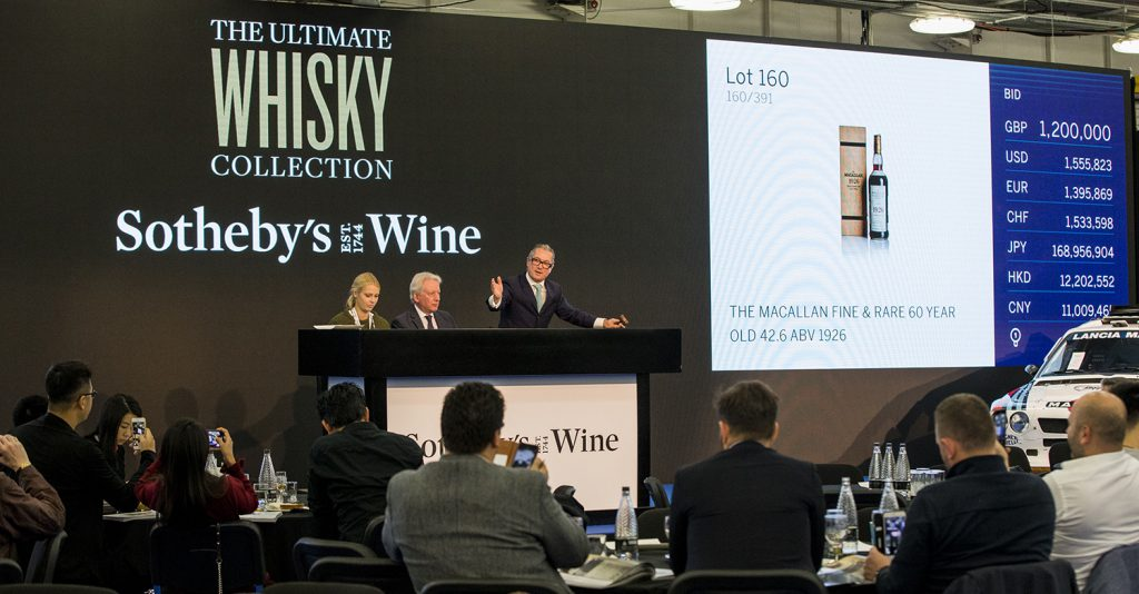 "Sotheby's Wine Chairman Jamie Ritchie calls on bidders during the ""Ultimate Whisky Collection"" auction at London's Olympia on October 24, 2019. Image courtesy Sotheby's."