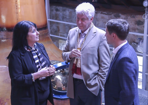 Speyside Distillers managing director Patricia Dillon (L) talks with CEO John McDonough and soccer star Michael Owen during a 2015 tour of the distillery. File photo ©2020, Mark Gillespie/CaskStrength Media.