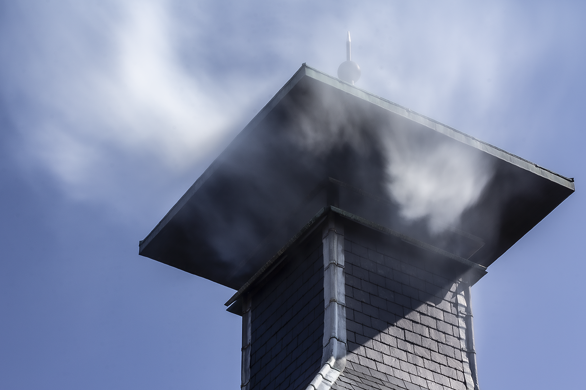 Peat smoke flows from the chimney at Highland Park Distillery in Kirkwall, Scotland. Photo ©2020, Mark Gillespie/CaskStrength Media.