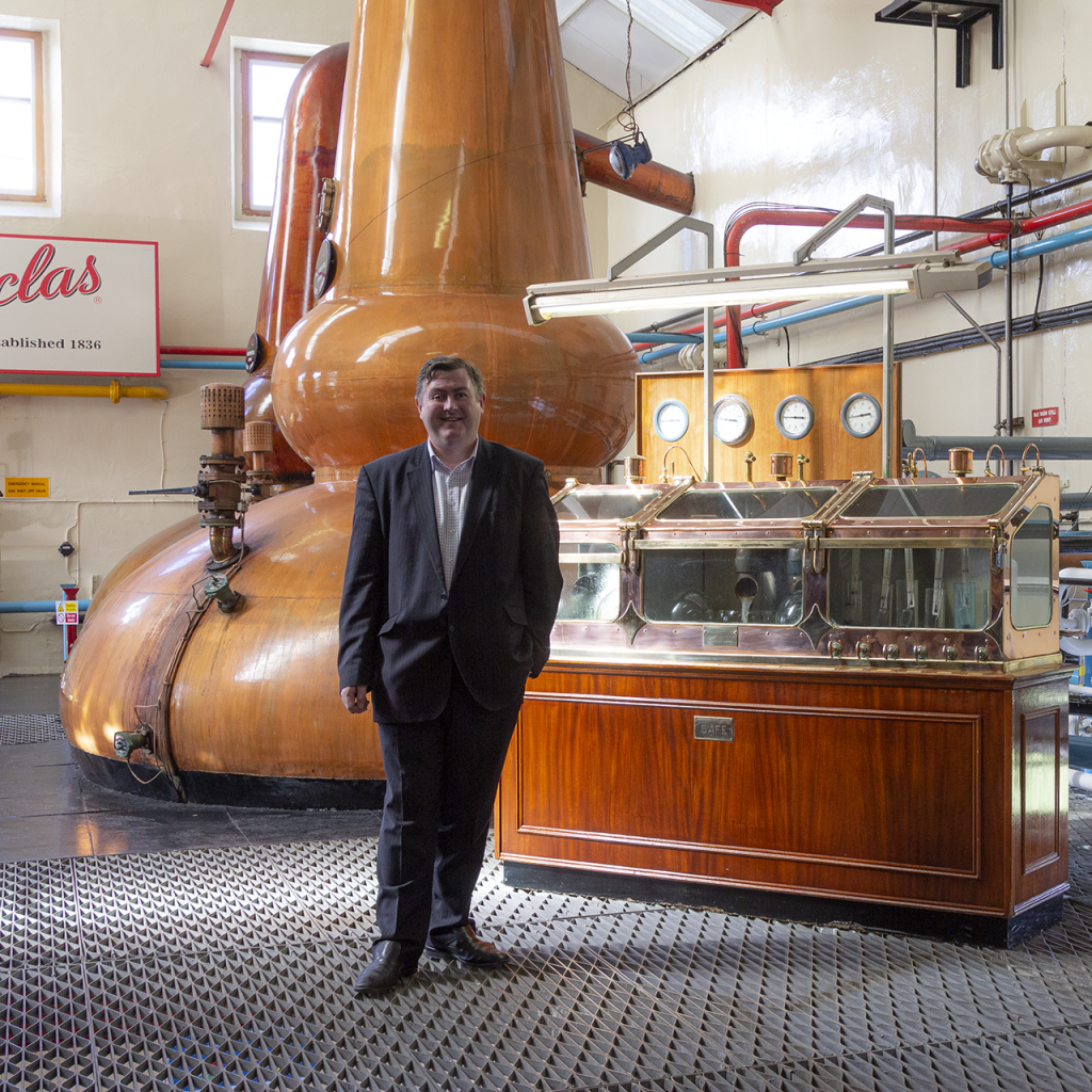 George S. Grant in the Glenfarclas stillhouse. File photo ©2020, Mark Gillespie/CaskStrength Media.