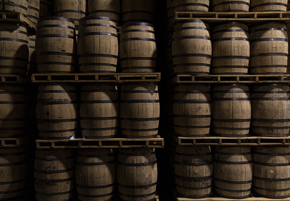 """There are two ways to store barrels of maturing whisky: on their sides or on their ends. Dunnage-style warehouses and rick houses store barrels on their sides, while """"palletized"""" warehouses store barrels stacked in pallets of six. Each style has its own proponents, and a few distilleries use both methods, including Diageo's Cascade Hollow (George Dickel) Distillery in Tennessee where this photo was made. We'll discuss the two styles in the Behind the Label segment on this week's WhiskyCast. Photo ©2020, Mark Gillespie, CaskStrength Media."""