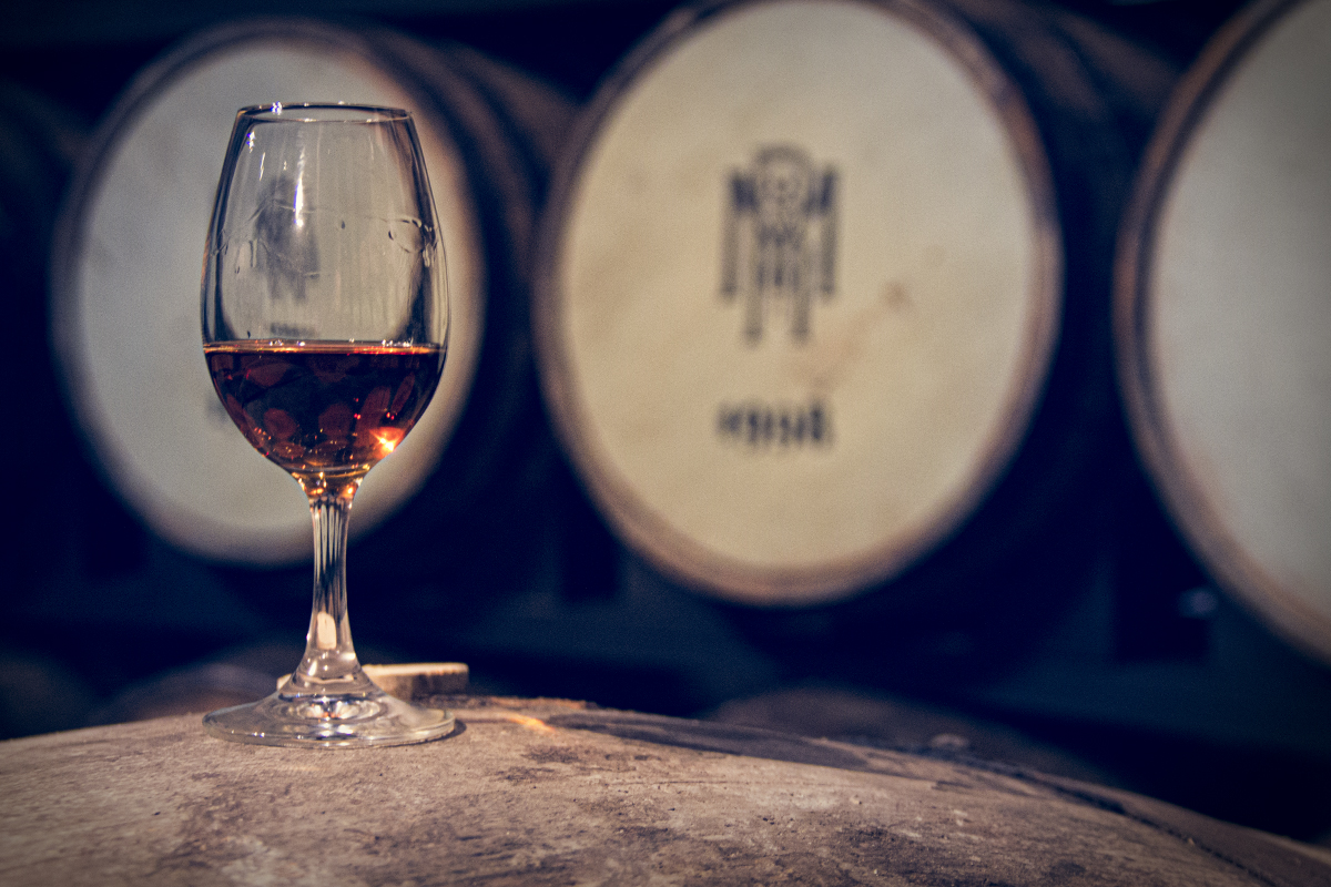 A glass of whiskey resting on a cask at Midleton Distillery in Ireland. File photo ©2020, Mark Gillespie/CaskStrength Media.