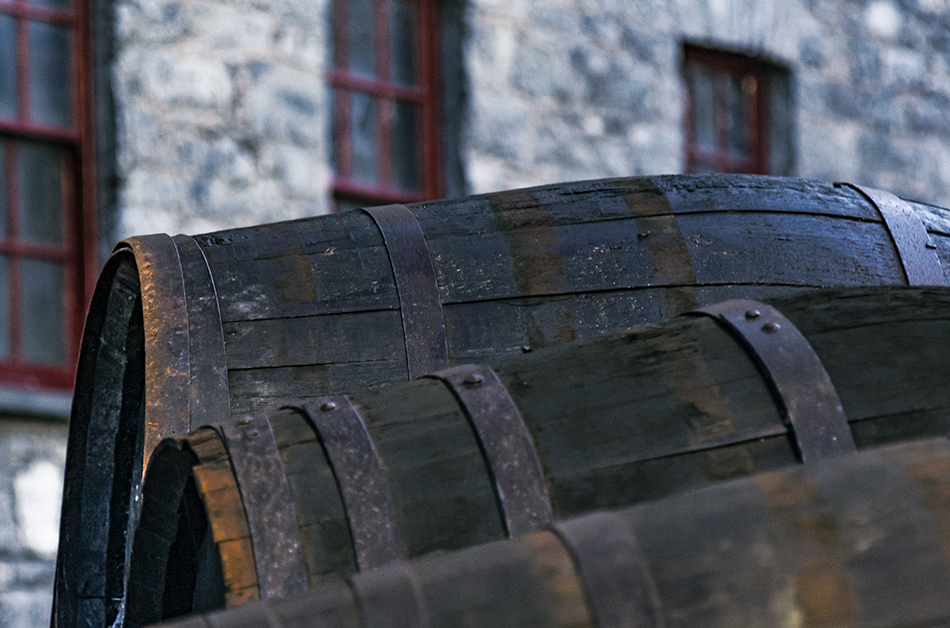 Distilleries tend to have lots of old barrels lying around, like these at Ireland's Midleton Distillery. Photo ©2021, Mark Gillespie/CaskStrength Media.