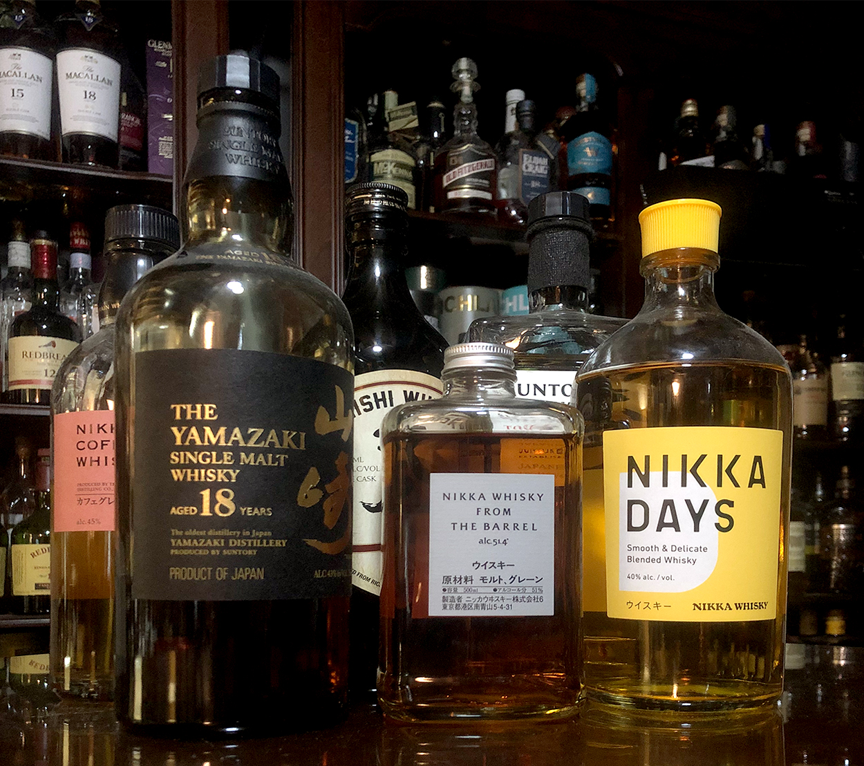 """Japanese whisky bottles, with two that no longer can be called """"Japanese Whisky."""" Photo ©2021, Mark Gillespie/CaskStrength Media."""